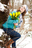 Woman with a bouquet of flowers at the park Stock Image