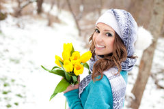 Woman with a bouquet of flowers at the park Stock Photography