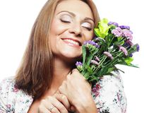 Woman with bouquet flowers Stock Photo