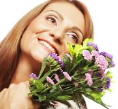 Woman with bouquet flowers Stock Images