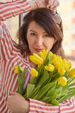 Woman with bouquet Royalty Free Stock Image