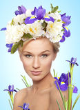 Woman with bouquet on head. Young blond naked woman with bouquet on her head stock photos