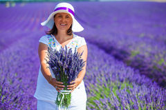Woman with bouquet of lavender flowers Royalty Free Stock Photos