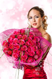 Woman with bouquet of pink roses Royalty Free Stock Photography