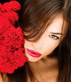 Woman and bouquet of a red carnations Royalty Free Stock Photography