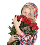 Woman with a bouquet of red roses Stock Photography