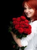Woman with a bouquet of red roses Royalty Free Stock Photography