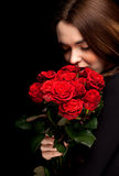 Woman with a bouquet of red roses Royalty Free Stock Image