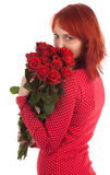 Woman with a bouquet of red roses Royalty Free Stock Photos