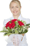 Woman with a bouquet of red roses Royalty Free Stock Images