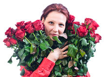 Woman with a bouquet of red roses Stock Image