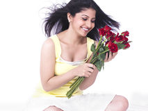 Woman with a bouquet of red roses Stock Images