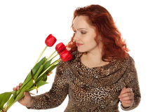 Woman with a bouquet of red tulips Royalty Free Stock Photos