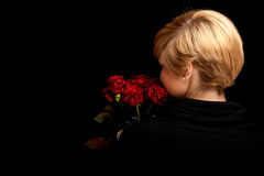 Woman with a bouquet of roses Stock Photo