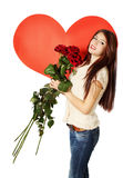 Woman with a bouquet of roses Stock Image