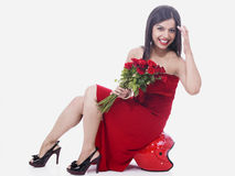 Woman with a bouquet of roses Royalty Free Stock Image
