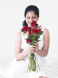 Woman with a bouquet of roses Royalty Free Stock Photography