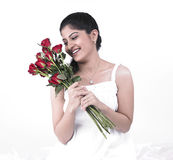 Woman with a bouquet of roses Stock Photos