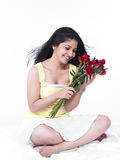 Woman with a bouquet of roses Stock Photography
