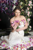 Woman with bouquet of roses Royalty Free Stock Photography