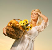 Woman with a bouquet of sunflowers Stock Images