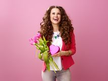 Woman with a bouquet of tulips and a box of chocolate Royalty Free Stock Image