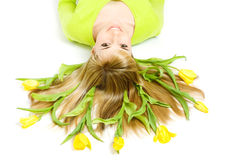 Woman with bouquet of tulips in her hair Stock Image