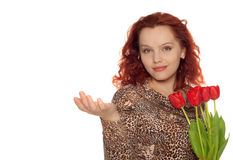 Woman with bouquet of tulips holding someth Royalty Free Stock Photo