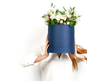 Woman with bouquet of wild roses flowers instead of head Stock Photo