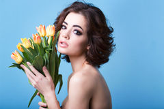 Woman with a bouquet of yellow tulips. Royalty Free Stock Photography