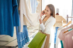 Woman in boutique Stock Photo