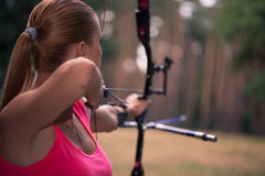 Woman with the bow Stock Images