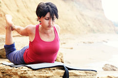 Woman in bow yoga pose Royalty Free Stock Image