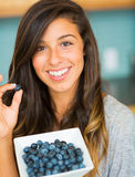 Woman With Bowl of Blueberries Royalty Free Stock Photo