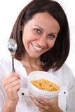 Woman with a bowl of cereal Royalty Free Stock Photography