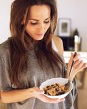 Woman with a Bowl of Cereal Royalty Free Stock Images