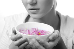 Woman and bowl of flowers Royalty Free Stock Photography