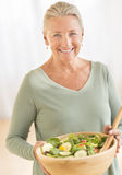 Woman With Bowl Of Salad At Home Stock Images