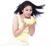Woman with a bowl of soup Stock Images