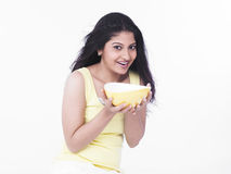 Woman with a bowl of soup Royalty Free Stock Photography