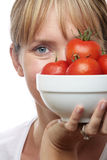 Woman with Bowl of Tomatoes Royalty Free Stock Image