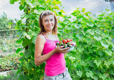 Woman with a bowl of vegetables Royalty Free Stock Image
