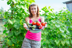 Woman with a bowl of vegetables Royalty Free Stock Photo