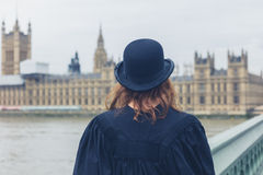 Woman with bowler hat at hopuses of parliament Royalty Free Stock Images