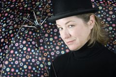 Woman in a bowler hat with umbrella Stock Photos