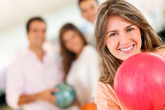Woman bowling Stock Images