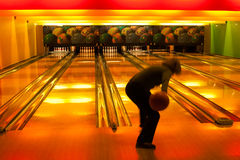 Woman bowling. A woman bowling in a bowling alley Stock Photography