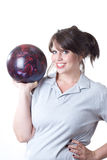 Woman with bowling ball. Young woman holding a bowling ball; isolated on a white background Royalty Free Stock Photo