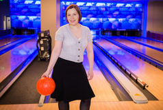 Woman with bowling ball Royalty Free Stock Images