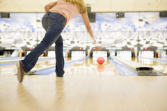 Woman bowling, rear view royalty free stock photography